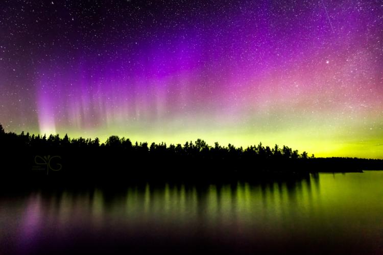 Aurora Borealis glow over Lehtisinsaari island in Ladoga lake